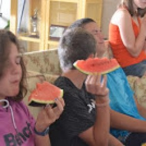 summer camps for teens, lenguaventura campers eating watermelon