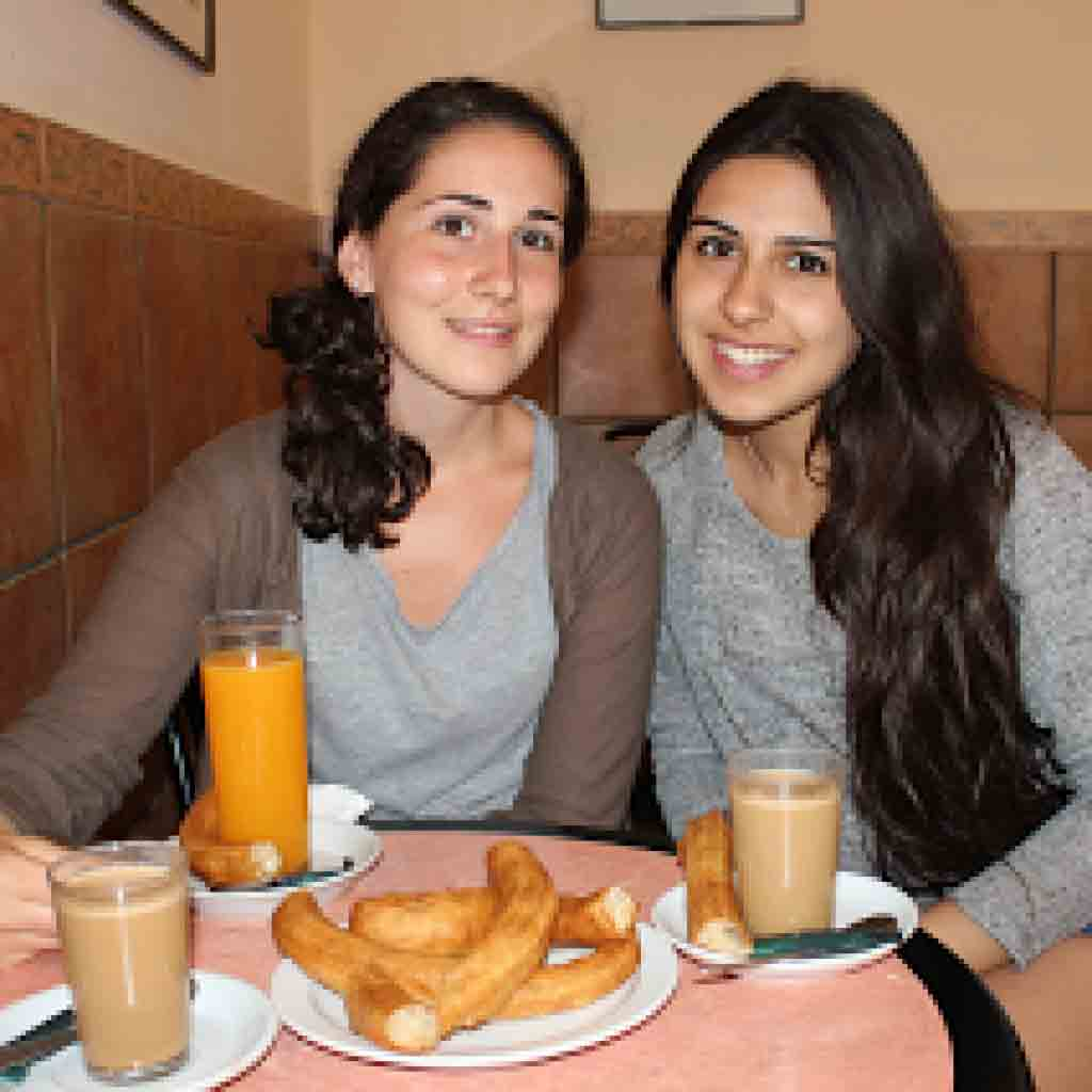 Summer-Camp-language-courses, eating churros in Tarifa