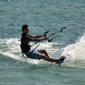 kitesurf camp for teens tarifa, kitesurfer on his board