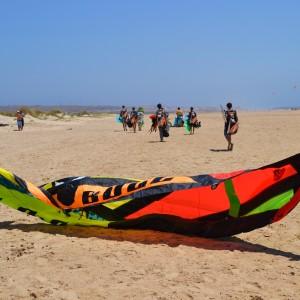 Kitesurf camp for teens, kitesurf students walking down to the beach