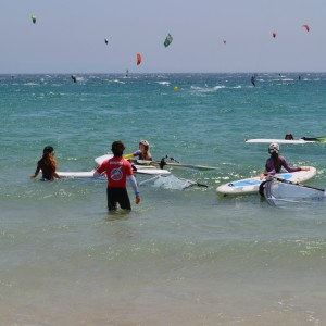 Windsurf camp for teens, girs windsurfer and their instructor