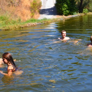 summer camps for teens, swimming in a nature pool