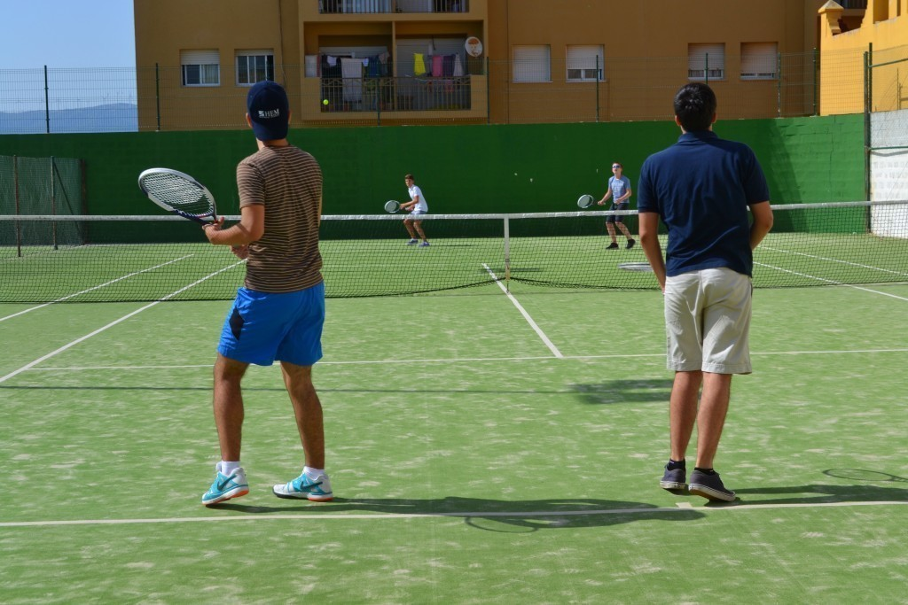 summer camps for teens, playing tennis with peers