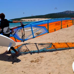Windsurf camp for teens, windsurfer with board and sail