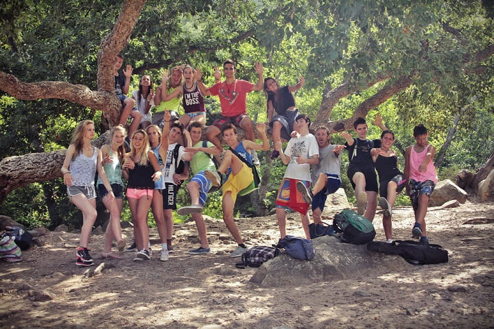 Adventure camp for teens, group picture in beautiful nature setting