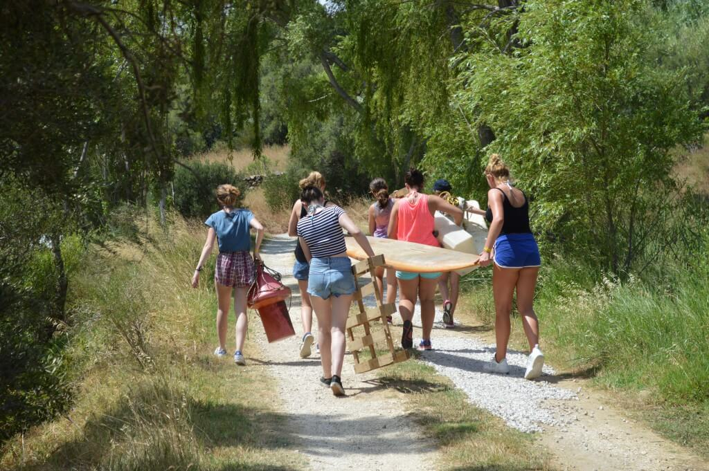 Summer camp program for young adventurers, raft building