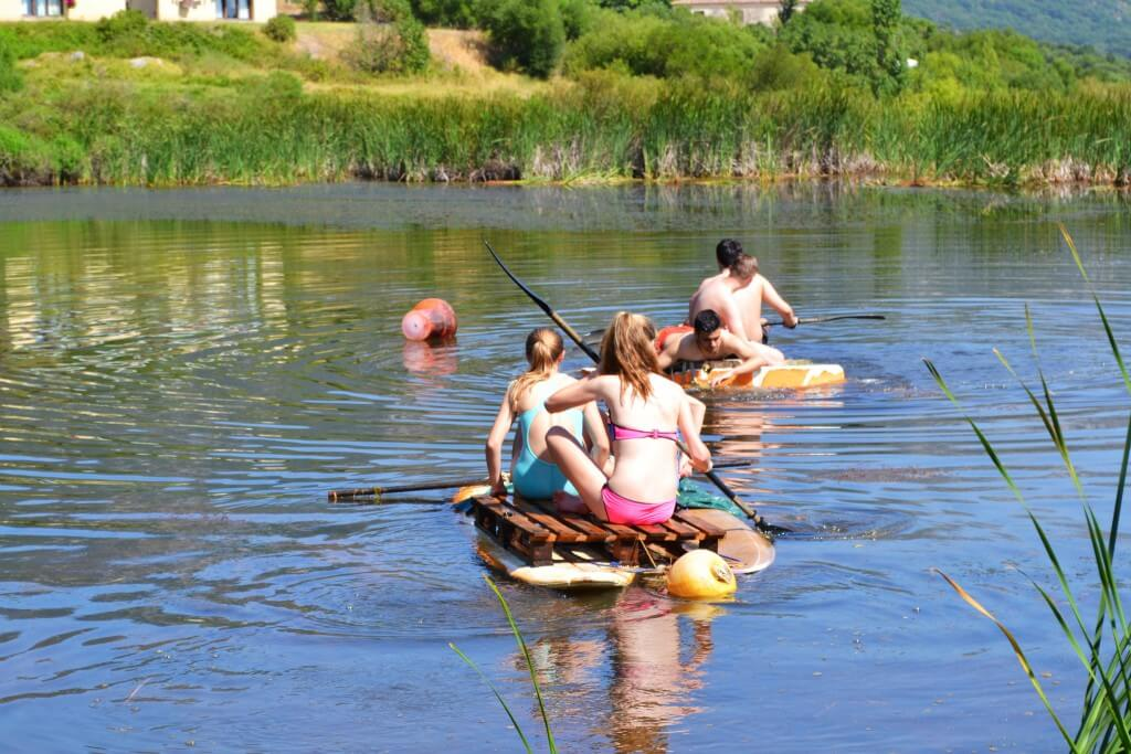 Adventure camp for teenagers, raft