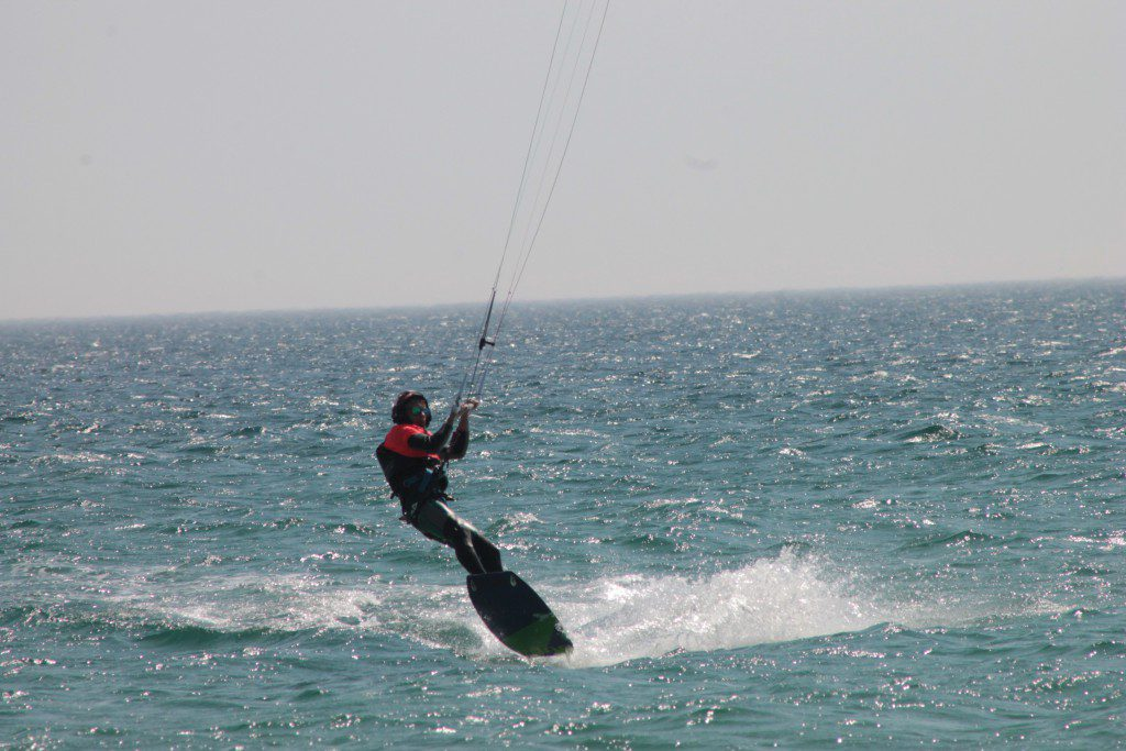 summercamps, enjoying kitesurf session Los Lances beach