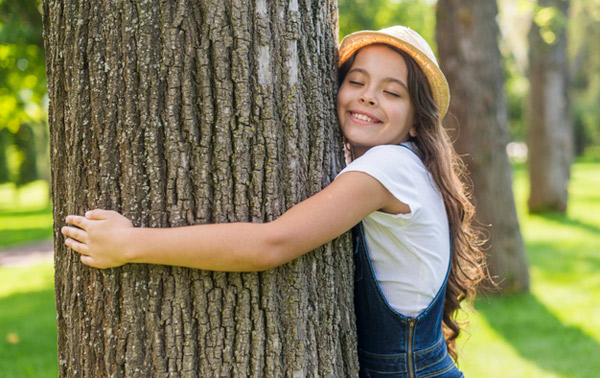 teenager-hugging-a-tree, breaking routine can be helpful